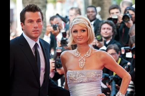 """(L-R) Actor Doug Reinhardt and actress Paris Hilton arrives at the premiere of """"Inglorious Basterds"""" at the 62nd Cannes Film Festival in Cannes."""
